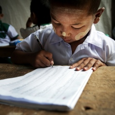 A child practices his writing during a kindergarten class in Tachilek, Myanmar. According to the UN Educational, Scientific and Cultural Organization (UNESCO), global literacy stands at 82%, with 18% of the world's adults – two-thirds women – still illiterate. Photo ID 491878. 13/06/2011. Tachilek, Myanmar. UN Photo/Kibae via flickrCC