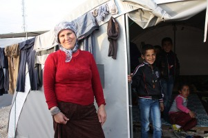 Syrian refugee, Aida Abdulrahman, 35, mother of six, outside her family's tent at municipal-run refugee camp, Suruc, S- E Turkey- European Commission DG ECHO's photostream via flickrCC